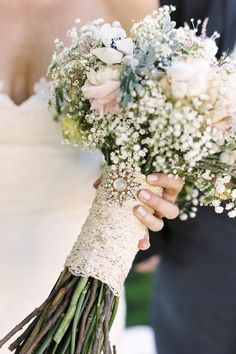 Simple Bouquet Pin - How To Incorporate Vintage Jewelry Into Your Bridal Look - Southernliving. You don't have to use a lot of jewelry in your bouquet. Simply attach a pin to your handle for a sweet touch. See the Pin Wedding Bells, Wedding Events, Our Wedding, Dream Wedding, Wedding Reception, Wedding Cake, Wedding Pins, Trendy Wedding, Bouquet Bride