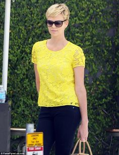 Charlize Theron in Madewell yellow lace top and Level 99 jeans