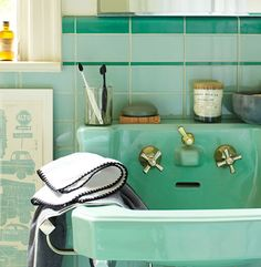 Mint green bathrooms make for a great start and end to the  day.