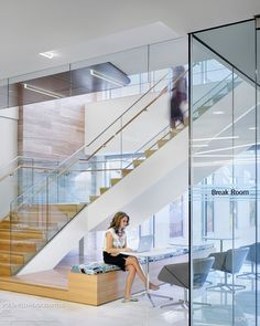 glass stair, seating at stair, wood stair