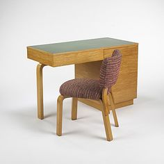 Lot 260: Alvar Aalto. desk and chair. c. 1950, birch, laminate, upholstery. 45 w x 22 d x 28 h in. result: $4,200. estimate: $3,000–4,000. chair measures: 19 w x 21 d x 29 h Signed with stamped manufacturer's mark to underside: [Finsven Made in Finland].
