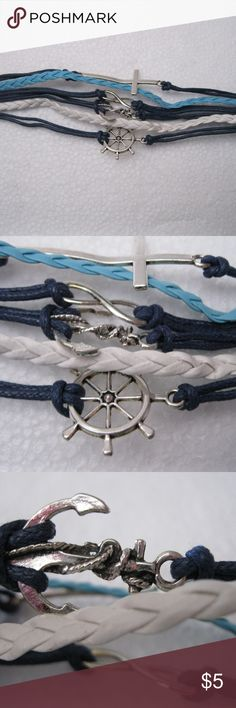 """Women/Teen Girl Leather Adjustable  Bracelet OSFM Women/Teen Girl Leather Adjustable  Bracelet OSFM...Navy blue and white.  Adjustable clasp.  Charms are Anchor, cross ,ships wheel and more.  Bracelet measures 6.5"""", not including chain and clasp.  Cute fashion statement at a great price. NEW Unknown Jewelry Bracelets"""