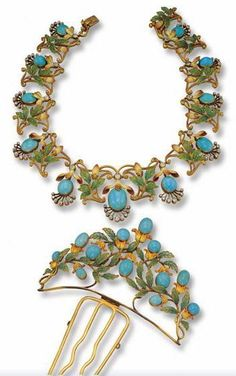 This Art Nouveau plique-á-jour enamel turquoise and diamond necklace and hair comb sold Dec 10, 2002. The comb is a triangular cluster set with oval-shaped turquoise cabochons. These are the flowers coming out of translucent yellow-orange enamel buds, which are then surrounded by green plique-á-jour enamel leaves. The matching necklace also features old-mine and rose-cut diamonds.