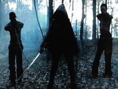 The Walking Dead Season 2 finale featured this incredibly badass image of a hooded stranger carrying a katana, flanked by two jawless, armless walkers.  Hell yes.