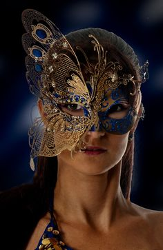 # GOLD W/ BLUE BUTTERFLY MASK                                                                                                                                                                                 More