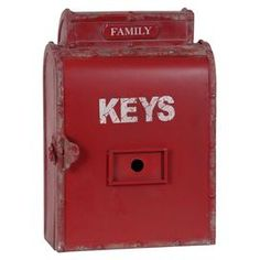 """Metal key box with typographic details.  Product: Key boxConstruction Material: MetalColor: RedFeatures: Perfect hung on a wall or sitting on a shelfDimensions: 15.5"""" H x 11"""" W x 5.25"""" D"""