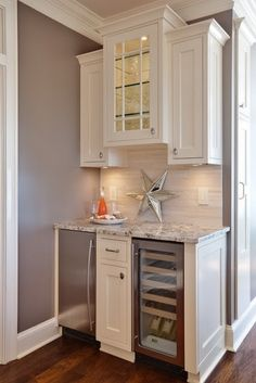 Kitchen/family room Beverage Bar Idea-maybe modify it so it just isn't liquor but also for coffee? Tall enough for my beverage dispensers for parties