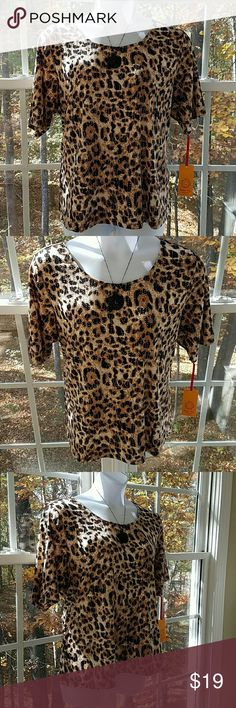 🆕Ruby Rd Plus Size On the Prowl Animal Print Top Beautiful animal print top from Ruby Rd. scattered with awesome gold studs. 95% Polyester and 5% Spandex. Hand wash cold. Ruby Rd Tops Blouses