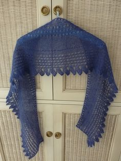 Ravelry: Project Gallery for Edith Shawl pattern by Sarah Hatton.  I'm not generally a fan of knitting scarves and shawls, but this one is really beautiful, uses one of my favorite yarns, and looks to knit up quickly.