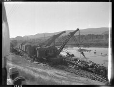 """Caption: """"Engleside Spur derailment of NP 2655, Class A-2 and Train X2655E/652's which derailed because of washout due to cloudburst. View two wreckers lifting on derailed 2655."""" Date: June 1935 Location: Willow Creek, MT Photographer: Ron V. Nixon Railroad: Northern Pacific Railway Station: Willow Creek --- USA"""
