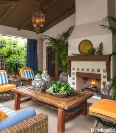 In the covered outdoor living room of a Santa Monica, California, home, designer David Dalton created a relaxing year-round space with insulated Sunbrella curtains and a fireplace decorated with custom Talavera tiles by Mission Tile West. Spanish Style Homes, Spanish House, Spanish Revival, Spanish Colonial, Outdoor Rooms, Outdoor Living, Outdoor Decor, Indoor Outdoor, Outdoor Retreat