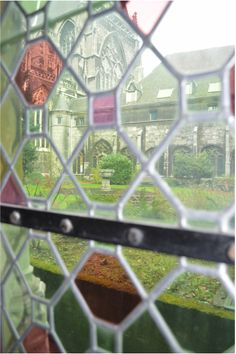 When you're heading to Belgium, be sure to visit Liège, with its historical center on the one hand and vibrant university district on the other hand! View through stained glass window on inner garden of the Cathedrale St Paul (vue prise du Cloître)