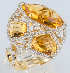 Statement ring featuring 8.24ct of citrine contoured to organic shape of the original rough stone. Each stone hand worked in delicate 14k gold, bordered by .99ct in diamonds. Produced by designer Michael Christoff.  $1,279.99