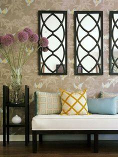 mirrors over sofa, flower display by StarMeKitten