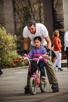 Learning to ride a bike, with Daddy teaching.....: