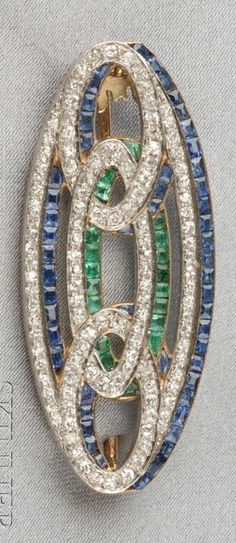 An Art Deco Platinum, 18kt Gold, Diamond, and Gem-set Brooch, France. Set with calibré-cut sapphires and emeralds, and old single- and old mine-cut diamonds, engraved gallery, length 1 3/4 in., numbered, maker's mark and guarantee stamps.