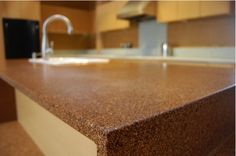 eco-friendly and good-looking countertops are made from walnut shells suspended in zero V. Dubbed Nuxite, the material is stain resistant and light-weight. They are also formaldehyde free and don't emit fumes making them kitchen-friendly. Milk Crate Storage, Milk Crates, Recycled Countertops, Kitchen Countertops, Kitchen And Bath, Diy Kitchen, Kitchen Ideas, Kitchen Planning, Walnut Shell