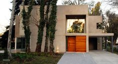 Completed in 2008 in Tandil, Argentina. A corner lot in the best area of April country club, located in what was once the area's original ranch house, retaining old trees that gave, in. Old Trees, Ground Floor Plan, Main Door, Commercial Architecture, Patio, Back Gardens, Villa, Floor Plans, Exterior