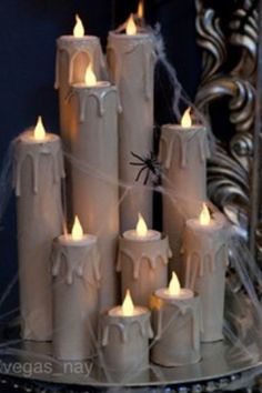 Paper towel rolls, candle wax, and tea light candles