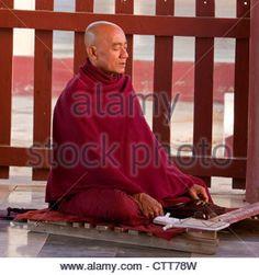 Myanmar, Burma, Shwezegon (Shwezigon) Pagoda, near Bagan. Monk Meditating, Praying. - Stock Image