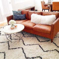 the coffee table i am obsessed with...and it's nice and small. Also LOVE the cognac leather sofa and the lines!