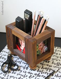 This photo frame wooden DIY desk organizer is easy to build and perfect for Dad to take to the office. And it's easy enough to build that the kids can help!
