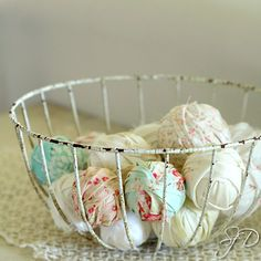 A pretty, fresh take on fabric balls... Love the wire basket for organizing/displaying!