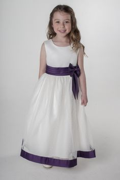 Ivory & Purple Bow Flower Girl Dress available with other colour accents, visit our website. UK supplier ships worldwide.