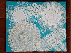Vintage & antique doilies, buttons on canvas painted turquoise via Etsy