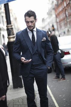 3 piece suit with double breasted waistcoat. Paired with dotted knitted necktie and contrasting pocket square