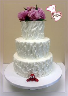 Sweet Art by Lucila three tier butter cream wedding cake designed to be also a groom cake, notice small Spiderman figurine at the bottom tier.