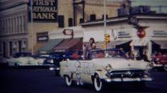 1952: Homecoming queens for each high school class grade parade floats. . http://www.pond5.com/stock-footage/58883024?ref=StockFilm keywords:High School, parade, pep rally, students, girls, queens, proud, First National Bank, Barbara King, Karen Roberts, classic cars, beauty, popular girls, community, crowds, watching, show off, cute girls, homecoming, 1952, Homecoming, high, school, class, grade, floats