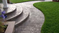 Ideas for my front yard.  Stamped Concrete - Ashler Patterned walkways with Textured Steps