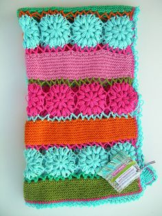 Image only ~ no pattern.  I'm liking the combination of knit rows with crochet flowers.