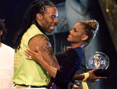"1999: Rapper Busta Rhymes hugs Janet Jackson after winning Music Video of the Year for their duet ""What's It Gonna Bez?!"" at the Source Hip Hop Music Awards in Los Angeles. The video for the sexually-charged track, directed by Hype Williams, is one of the most expensive of all time."