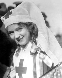 "Red Cross"" Mary Pickford at the head of a huge parade, San Francisco, December 21, 1917."