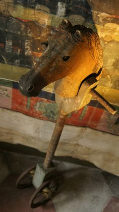 19th century toy horse on wheels ....wood/faded paint