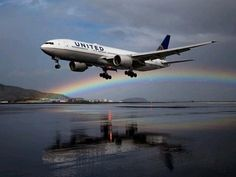 United Boeing 777 approaching in rainbow