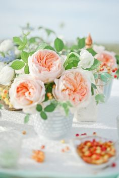 Wedding reception ceremony Gorgeous garden roses ... look like PEONIES ... photography by Leila Brewster / Floral Design by Ariel Dearie Flowers ... rustic glamorous, vintage, country elegance, shabby chic