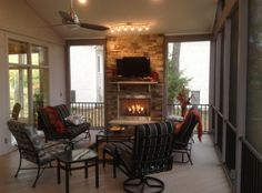 Screened porch with AZEK flooring and fireplace | Is the cold weather keeping you inside your home?  It doesn't have to!