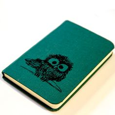 Notebook. Could make a cute gift. Buying a fabric notebook, and then drawing something on the front. Cute.