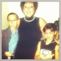 Lol little Christina with Mark and Momma Grimmie. Of course she has her gameboy... ^_^