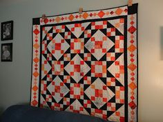 Sew~Amy ~ My Halloween/ Spider Web quilt hanging up.  Scrappy orange with black Jacob's ladder. Hand embroidered spider webs/spiders.