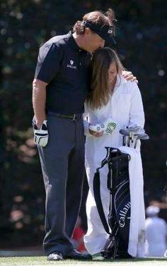 Phil Mickelson of the U.S. kisses his daughter. - MIKE SEGAR/Newscom/Reuters