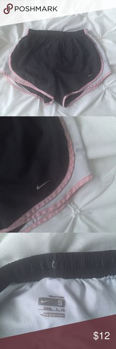 Nike Dri Fit Dark Gray, Pink, and White Shorts Nike Dri Fit Dark Gray, Pink, and White Shorts- size small- outside in perfect condition- inside has tear (as shown in picture- cannot be seen when worn) and is priced as so Nike Shorts
