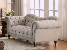Homelegance Chesterfield Traditional Style Loveseat with Tufting and Rolled Arm Design in Brown/Almond - DealBeds.com