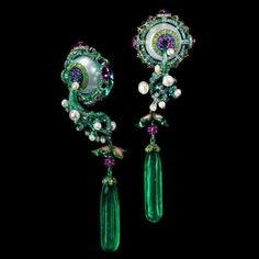 Wallace Chan Birth and Blossom earrings with two 30.88 carat emerald drops suspended from titanium stems set with pearls, diamonds and pink sapphires. The best from TEFAF 2017, the most diverse vintage, antique and modern art, design, jewellery and watch fashion and luxury fair in Europe and America. http://www.thejewelleryeditor.com/jewellery/article/tefaf-maastricht-2017-jewellery-preview/ #jewelry