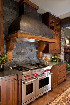 LOVE this kitchen!  Industrial with stone and slate.  Cool.