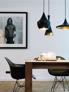 Dining room in Hamburg home with Beat lights from #TomDixon