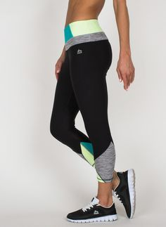 Elevate your workout in these color blocked capri length leggings. The capri length is the perfect fit for any height. Reflective details allow for a safe workout even in low lighting. Be irritation f